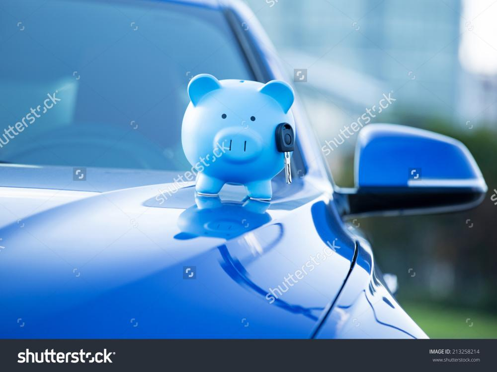 stock-photo-closeup-image-new-car-with-piggy-bank-key-on-hood-isolated-outside-corporate-building-dealership-213258214.jpg